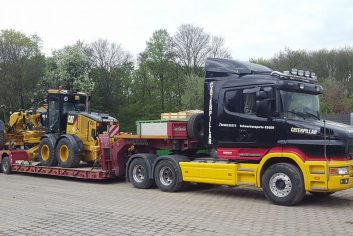Scania-T-580-mit-Bagger
